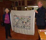 Mrs Haslam and Barry Clarke holding the completed Otago panel.